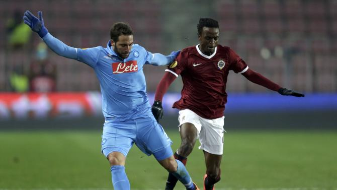Sparta Praha's Nhamoinesu fights for the ball with Napoli's Higuain during their Europa League soccer match at Stadion Letna in Prague