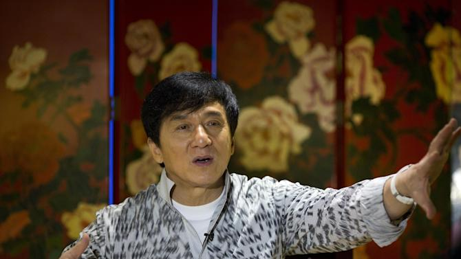 Action star Jackie Chan speaks during an interview in Beijing, Monday, Aug. 3, 2015. Action star Jackie Chan said Monday that he wants to work with his son Jaycee on a movie and an album as they mend their relationship after Jaycee was jailed on a drug charge. (AP Photo/Ng Han Guan)
