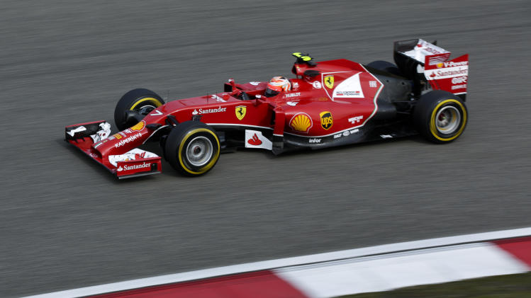 Ferrari driver Kimi Raikkonen of Finland steers his car during a practice session ahead of Sunday's Chinese Formula One Grand Prix at Shanghai International Circuit in Shanghai, China, Friday, April 18, 2014. (AP Photo/Alexander F. Yuan)