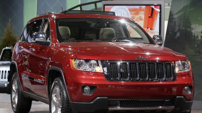FILE - In a Wednesday, Feb. 8, 2012 file photo, Jeep introduces the Jeep Grand Cherokee during the media preview of the Chicago Auto Show at McCormick Place in Chicago. Sales of Jeep Grand Cherokee and Dodge Durango SUVs are so strong that their factory will stay open through the normal 2012 two-week summer shutdown. Automakers typically close plants around the July 4 holiday to update cars and trucks for the new model year and maintain the machinery. (AP photo/Nam Y. Huh, File)