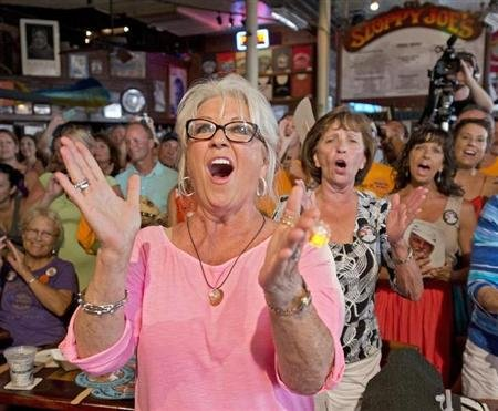 "Food Network television personality Deen cheers for her husband during the semi-finals of the ""Papa"" Hemingway Look-Alike Contest at Sloppy Joe's Bar in Key West"