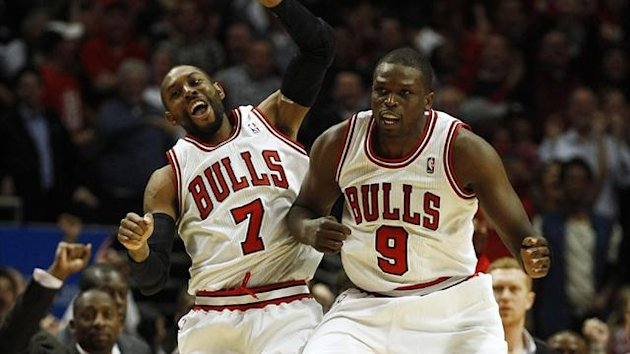 2011-12 NBA Chicago Bulls' C.J. Watson (L) and Luol Deng