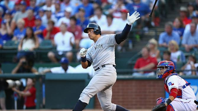 Alex Rodriguez of the New York Yankees hits a double against the Texas Rangers in the second inning at Globe Life Park in Arlington on July 28, 2015 in Arlington, Texas