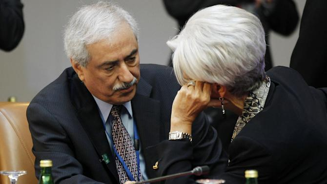 Fahad Al-Mubarak, governor of the Saudi Arabian Monetary Agency, left, talks with International Monetary Fund (IMF) Managing Director Christine Lagarde during a G-20 finance ministers and central bank governors meeting, Friday, April 20, 2012, at the IMF and World Bank Group Spring Meetings in Washington. (AP Photo/Charles Dharapak)
