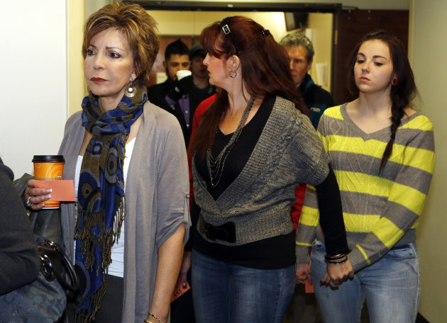Family members and victims line up to get into court for a preliminary hearing for Aurora theater shooting suspect james Holmes at the courthouse in Centennial, Colo., on Monday, Jan. 7, 2013.  Holmes
