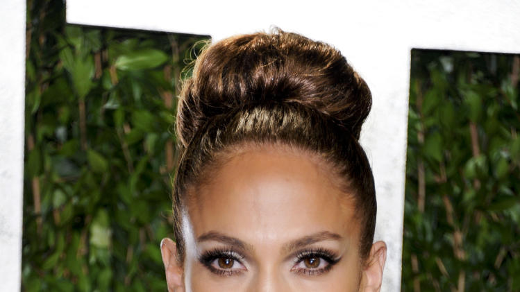 "FILE - In this Feb. 26, 2012 file photo, actress and singer Jennifer Lopez arrives at the Vanity Fair Oscar party in West Hollywood, Calif. Lopez was part of the all-star cast that helped lead ""Ice Age: Continental Drift"" to the top of the box office over the weekend, and the entertainer is eager to focus even more attention on her once white-hot movie career. She'll certainly have more time now that she's not going to be a judge on ""American Idol."" She announced last Friday that she will not be coming back to the Fox talent competition, following in the footsteps of fellow judge Steven Tyler, who announced a day earlier that he would leave the show to devote more time to his band, Aerosmith. (AP Photo/Evan Agostini, file)"