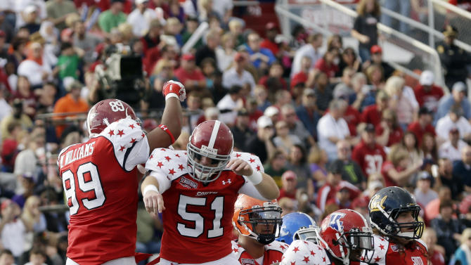 Senior Bowl South Squad tight end Michael Williams of Alabama (89) celebrates with teammate long snapper Carson Tinker of Alabama (51) after scoring in the first half of the Senior Bowl college football game at Ladd-Peebles Stadium in Mobile, Ala., Saturday, Jan. 26, 2013. (AP Photo/Dave Martin)