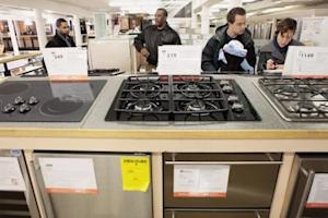 File photo of shoppers looking at durable goods appliances at a Home Depot store in New York