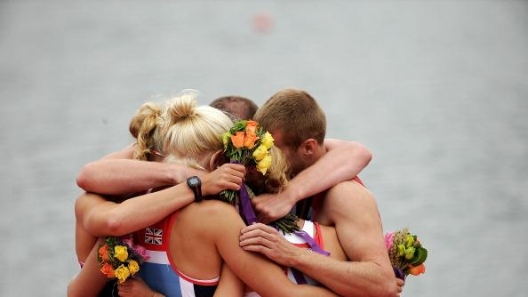The Great Britain Mixed Coxed Four Rowing - LTAMix4  team hug each other during the medal ceremony after winning gold on day 4 of the London 2012 Paralympic Games at Eton Dorney on September 2, 2012 in Windsor, England. (Photo by Matthew Lloyd/Getty Images)