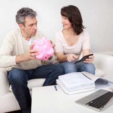 Mature-couple-saving-money-in-piggybank_web