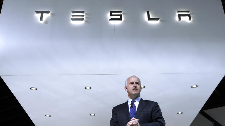 Tesla's shares soar on results, outlook