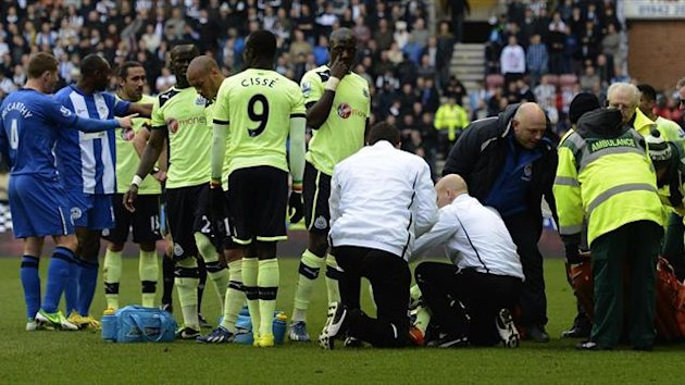 Wigan : Newcastle United's French defender Massadio Haidara receives attention on the pitch before being stretchered off the pitch after being injured in a tackle by Wigan Athletic's English striker Callum McManaman (AFP)