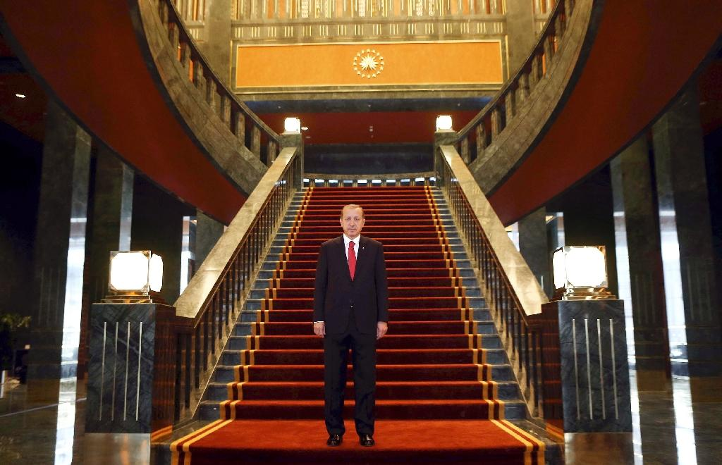 Anger and defiance as Erdogan takes aim at Turkey media