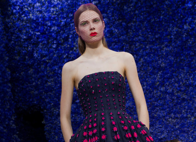 <p>               A model wears a creation by fashion designer Raf Simons for Dior, during his Women's Fall Winter 2013 haute couture fashion collection, during fashion week in Paris, France, Monday, July 2, 2012. (AP Photo/Jacques Brinon)