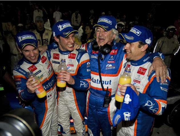 Team Oreca Matmut drivers Nicolas Lapierre, left, Loic Duval, second left, and Olivier Panis, right, join team owner Hughes de Chaunac in victory lane after winning the 59th annual American Le Mans Se
