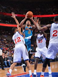 PHILADELPHIA, PA - JANUARY 15: Eric Gordon #10 of the New Orleans Hornets drives to the basket against Evan Turner #12 and Jason Richardson #23 of the Philadelphia 76ers during the game at the Wells Fargo Center on January 15, 2013 in Philadelphia, Pennsylvania. (Photo by Jesse D. Garrabrant/NBAE via Getty Images)