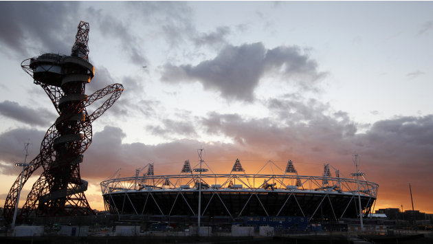 FILE This Wednesday, March  7, 2012 file photo shows the London 2012 Olympic Stadium  at sunset at the Olympic Park in London. The 2012 Olympics will showcase a much different London and a much differ