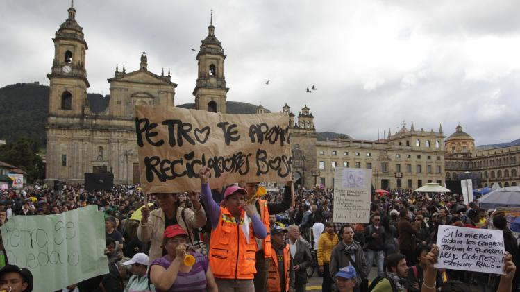 Demonstrators protest against a decision by Colombia's Inspector General Ordonez to remove Bogota's mayor Petro from his post at Bogota's Bolivar Square