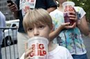 """Benjamin Lesczynski takes a sip of a """"Big Gulp"""" while protesting the proposed """"soda-ban,"""" that New York City Mayor Bloomberg has suggested, outside City Hall in New York"""