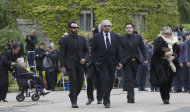Barry Gibb, second, left and Dwina Gibb, right, walk behind the funeral procession of Robin Gibb as they walk from the family home to St Mary&#39;s Church in Thame, England, Friday, June 8, 2012. Robin Gibb a member of the iconic Bee Gees pop group died May 20, after a long battle with cancer.(AP Photo/Alastair Grant)