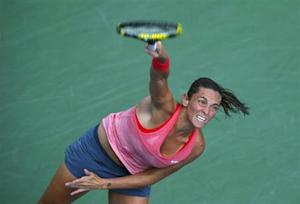Vinci of Italy serves to compatriot Giorgi at the U.S. Open tennis championships in New York