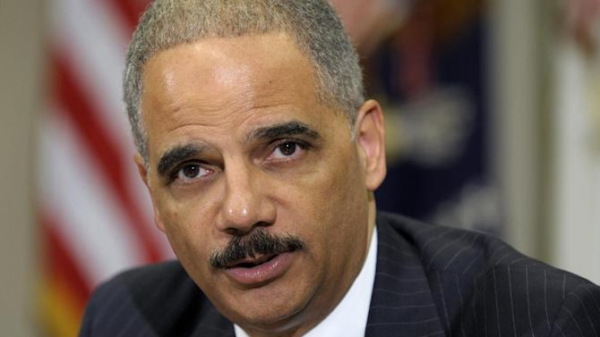Attorney General Eric Holder speaks in the Cabinet Room of the White House in Washington, Thursday, July 26, 2012, where he announced the formation of a public-private partnership to fight fraud in the health care system. (AP Photo/Susan Walsh)