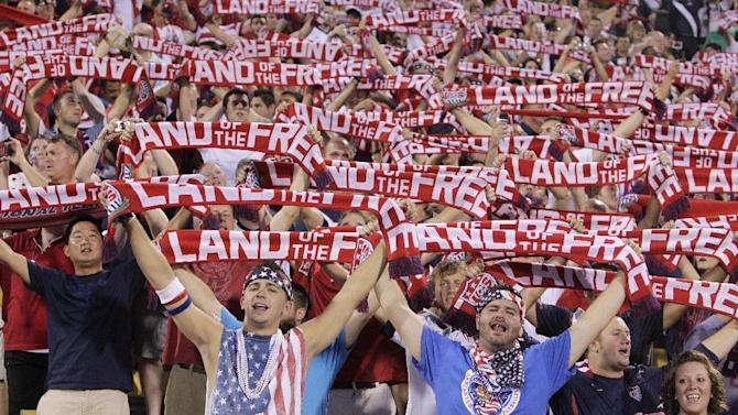 United States fans hold up scarves as they sing the national Anthem before the start of the qualifying soccer match against Mexico in a World Cup, Tuesday, Sept. 10, 2013, in Columbus, Ohio. (AP Photo/Jay LaPrete)