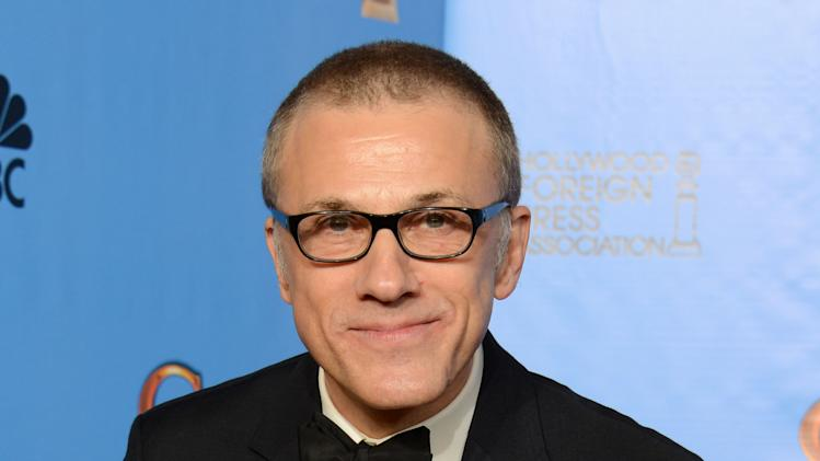 "Christoph Waltz poses with the award for best performance by an actor in a supporting role in a motion picture for ""Django Unchained"" backstage at the 70th Annual Golden Globe Awards at the Beverly Hilton Hotel on Sunday Jan. 13, 2013, in Beverly Hills, Calif. (Photo by Jordan Strauss/Invision/AP)"