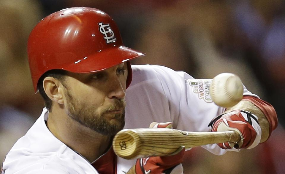 St. Louis Cardinals' Adam Wainwright bunts during the sixth inning of Game 4 of baseball's National League championship series against the San Francisco Giants Thursday, Oct. 18, 2012, in St. Louis. (AP Photo/David J. Phillip)