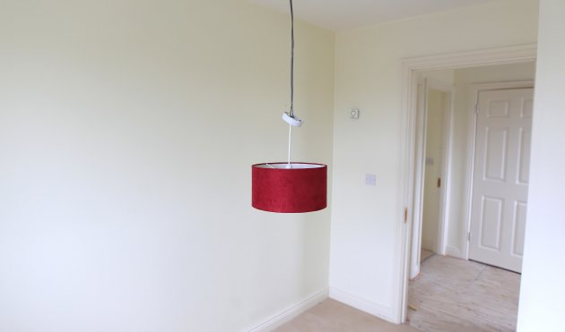A light fitting hangs from the ceiling in a show home on the Glenall housing estate in the village of Borris-in-Ossory, County Laois
