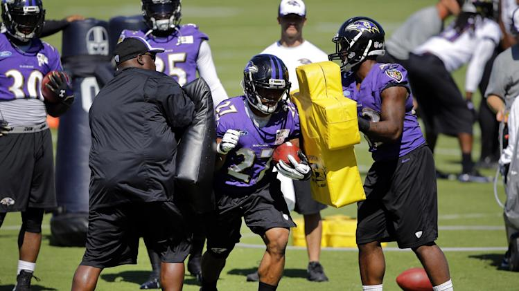 Baltimore Ravens running back Ray Rice, center, runs a drill during a training camp practice, Friday, July 25, 2014, at the team's practice facility in Owings Mills, Md. Rice received a two-game suspension from the NFL on Thursday following his offseason arrest for domestic violence. (AP Photo)