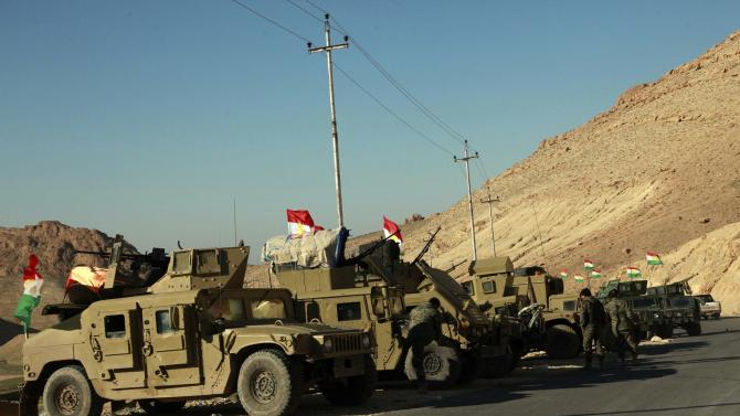 Military vehicles of Kurdish security forces are seen at Mount Sinjar, in the town of Sinjar