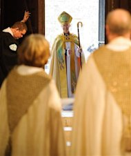 The new Archbishop of Canterbury Justin Welby arrives for his enthronement ceremony at Canterbury Cathedral, in Canterbury, southern England March 21, 2013. The new spiritual leader of the world's Anglicans was enthroned by a female cleric on Thursday, taking the helm at a time when the troubled church risks tearing itself apart over gay marriage and women bishops. REUTERS/Dominic Lipinski/Pool
