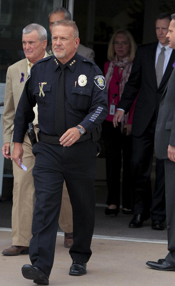 Westminster Police Chief Lee Birk, center and Jefferson County District Attorney Scott Storey, left, walk out to announce the arrest of Austin Reed Sigg,17, for the murder of Jessica Ridgeway at the Westminster Police Station Wednesday, Oct. 24, 2012 in Westminster CO.. (AP Photo/Barry Gutierrez)
