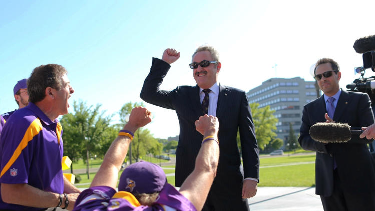 Minnesota Vikings owner Zygi Wilf greets fans outside the state Capitol before a news conference after the Vikings stadium bill passed in the Senate and the House on Thursday, May 10, 2012, in St. Paul, Minn. At righ tis Vikings president Mark Wilf. (AP Photo/Star Tribune, Renee Jones Schneider) ST. PAUL OUT  MINNEAPOLIS-AREA TV OUT  MAGS OUT
