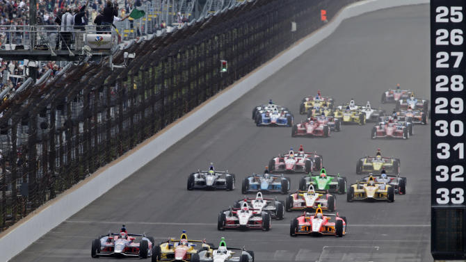 Ed Carpenter leads the field as the cross the start/finish line on the start of the Indianapolis 500 auto race at the Indianapolis Motor Speedway in Indianapolis  Sunday, May 26, 2013. (AP Photo/AJ Mast)