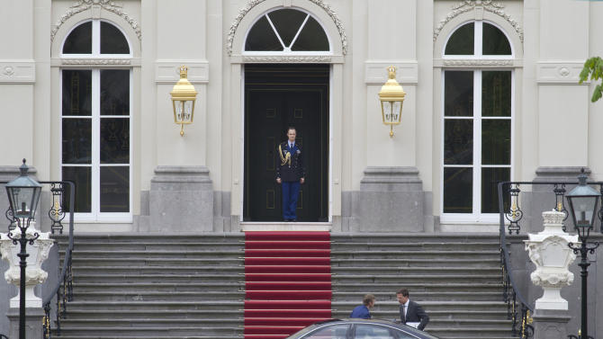 Dutch prime minister Mark Rutte, bottom right, gets into his car as he leaves royal palace Huis ten Bosch after meeting with Dutch Queen Beatrix in The Hague, Netherlands, Monday April 23, 2012. Rutte is reported to have handed in his resignation to the Queen after seven weeks of talks to hammer out an austerity package aimed at bringing the Dutch budget deficit back within European Union limits collapsed Saturday. (AP Photo/Peter Dejong)