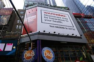 """A billboard advertising the defunding of """"Obamacare"""" the ACA, paid for by the conservative Heritage Foundation, is pictured in New York"""