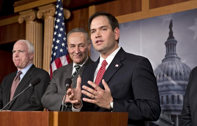 Sen. Marco Rubio, R-Fla., center, takes a reporter&#39;s question as a bipartisan group of leading senators announce that they have reached agreement on the principles of sweeping legislation to rewrite the nation&#39;s immigration laws, during a news conference at the Capitol in Washington, Monday, Jan. 28, 2013. From left are Sen. John McCain, R-Ariz., Sen. Charles Schumer, D-N.Y., and Sen. Marco Rubio, R-Fla. The deal covers border security, guest workers and employer verification, as well as a path to citizenship for the 11 million illegal immigrants already in this country. (AP Photo/J. Scott Applewhite)
