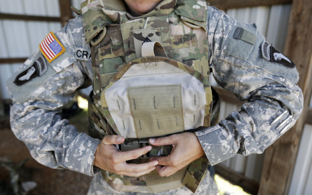 Sgt. Bobbie Crawford removes her new body armor after training on a firing range on Tuesday, Sept. 18, 2012, in Fort Campbell, Ky. Female soldiers from 1st Brigade Combat Team, 101st Airborne Division
