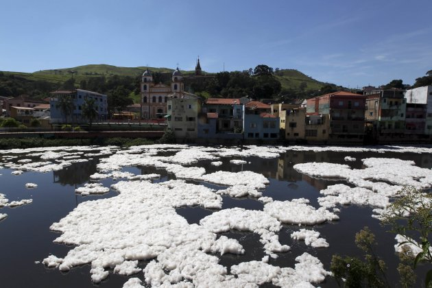 Foam from industrial waste floats on the polluted Tiete River in Pirapora do Bom Jesus