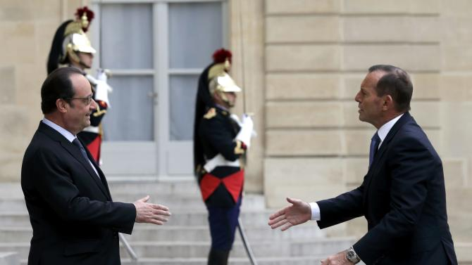 French President Hollande welcomes Australian Prime Minister Abbott at the Elysee Palace in Paris