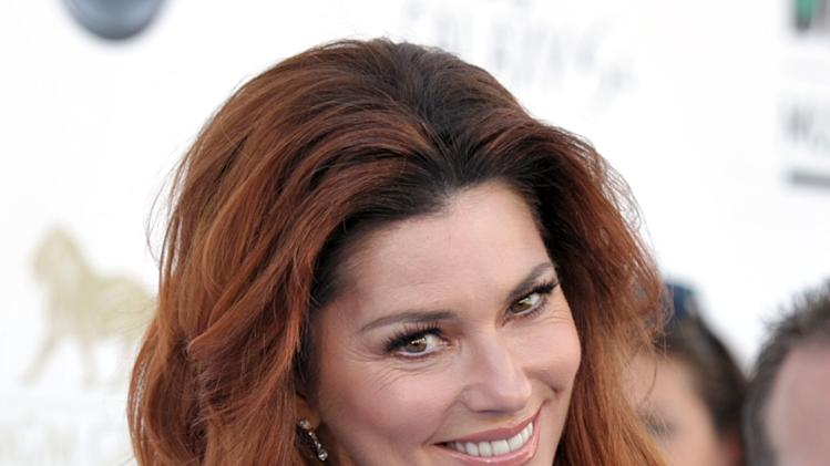 Shania Twain arrives at the Billboard Music Awards at the MGM Grand Garden Arena on Sunday, May 19, 2013 in Las Vegas. (Photo by John Shearer/Invision/AP)
