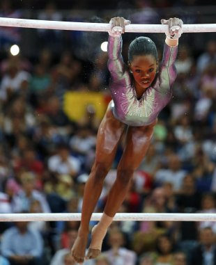 Gabrielle Douglas of the U.S. competes in the women's gymnastics asymmetric bars final in the North Greenwich Arena during the London 2012 Olympic Gam...