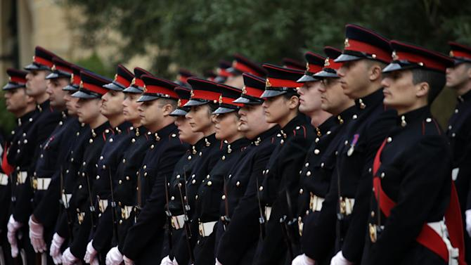 The honor guard wait for the arrival of Britain Queen Elizabeth II and The Duke of Edimburgh, at St. Anton presidential palace in Valletta, Malta, Thursday, Nov. 26, 2015. The 89-year-old British monarch has flown to the Mediterranean island of Malta, where she once lived as a young princess, for a summit of the Commonwealth, the post-colonial international alliance she has helped for decades to unite. (AP Photo/Alessandra Tarantino)