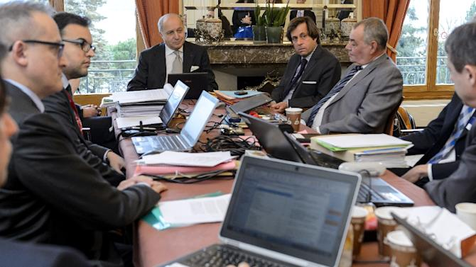 French Foreign Minister Laurent Fabius (C) and director-general for political and security affairs at the French Foreign Ministry Nicolas de Riviere (C-R) attend working session with their team on March 29, 2015 during Iran nuclear talks in Lausanne