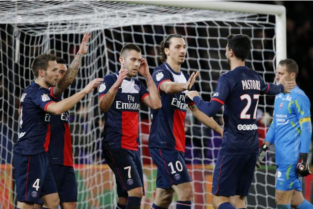Paris Saint Germain's Zlatan Ibrahimovic celebrates his goal against Valenciennes with team mates during their French Ligue 1 soccer match at Parc des Princes Stadium in Paris