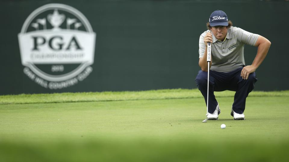 Jason Dufner lines up a putt on the eighth hole during the second round of the PGA Championship golf tournament at Oak Hill Country Club, Friday, Aug. 9, 2013, in Pittsford, N.Y. (AP Photo/Charlie Neibergall)