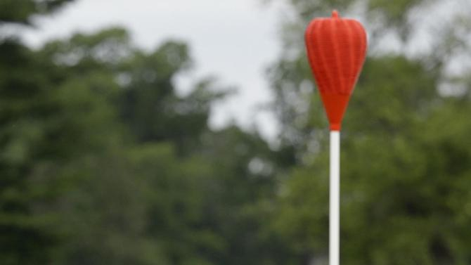 Tiger Woods chips onto the 18th green during the first round of the U.S. Open golf tournament at Merion Golf Club, Friday, June 14, 2013, in Ardmore, Pa. (AP Photo/Gene J. Puskar)
