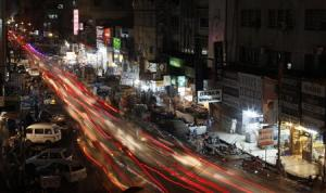 A view is seen of a busy street in Karachi